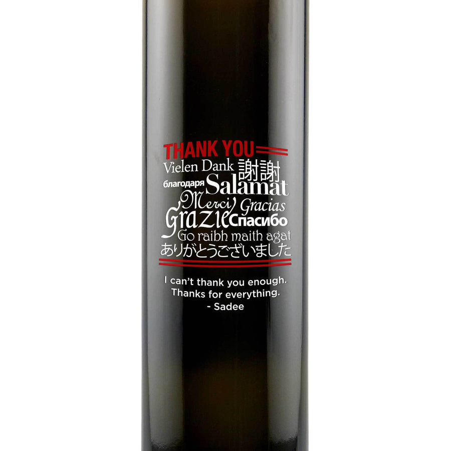 Thank You engraved in multiple different languages on a glass olive oil bottle by Etching Expressions