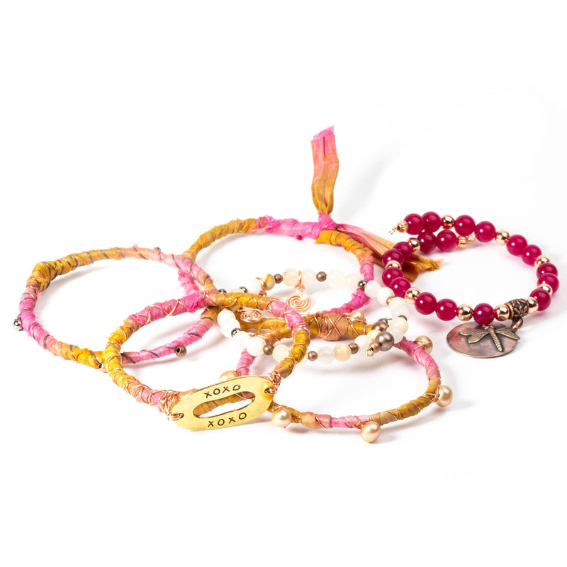 Stackable bracelets with charms.