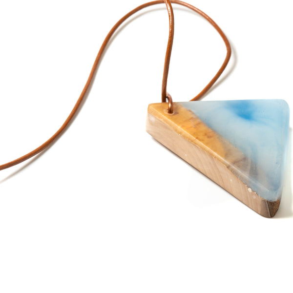 top view of white resin and wood pendant