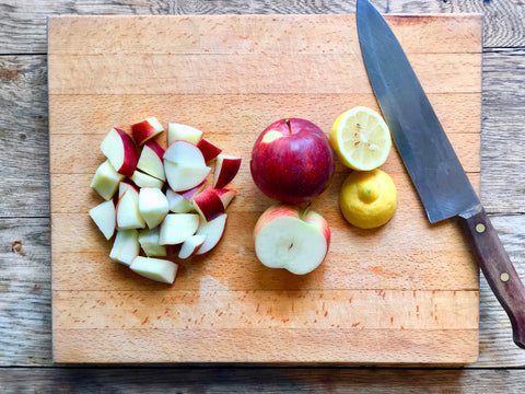 Empire apples and organic lemon sliced for homemade applesauce.
