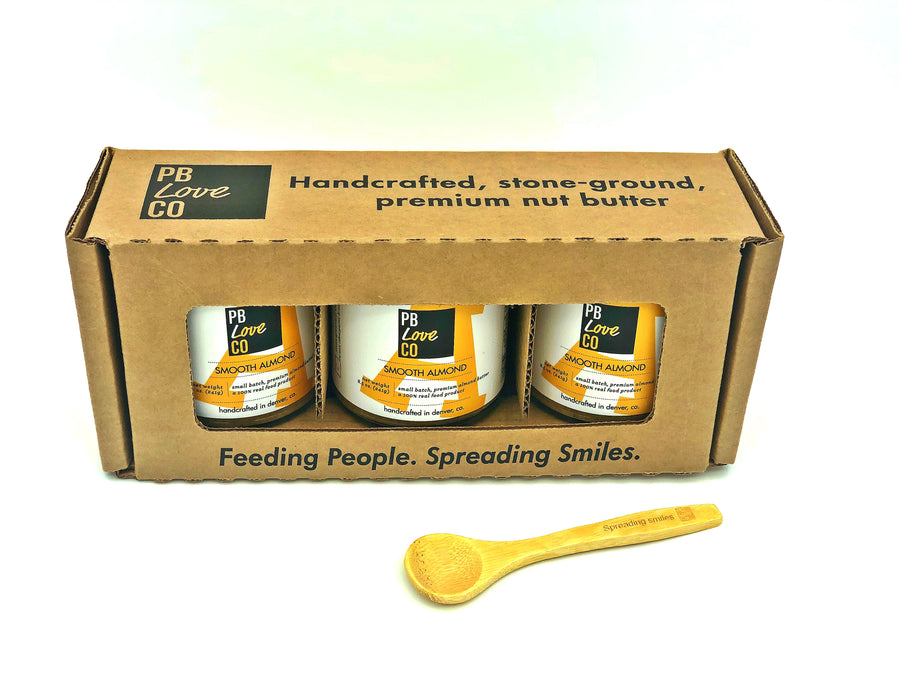 PB Love Co Gift Boxes 1 box with bamboo spoon image - 3 Smooth Almond jars.