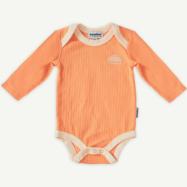 Peach Ribbed Organic Cotton Long Sleeve Onesie