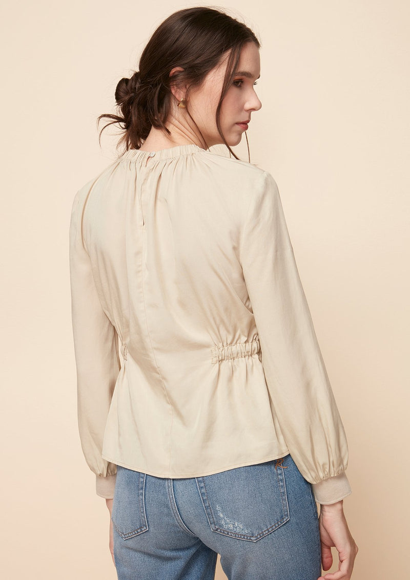 LONG-SLEEVED BLOUSE WITH STOPPER