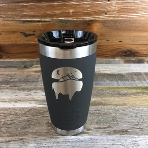 Bison Moon Tumbler | 20 oz | Charcoal The WyoMade Bison Moon Tumbler is pure beverage containment for 20 ounces of your favorite hot or cold drink.  It comes with a smooth-flow sippy-lid for direct beverage enjoyment.  This Charcoal colored Tumbler is designed for any Wyoming lifestyle and will surely allow you to roam free with your favorite beverage.  Bring some life to the herd with a Bison Moon Tumbler from WyoMade.