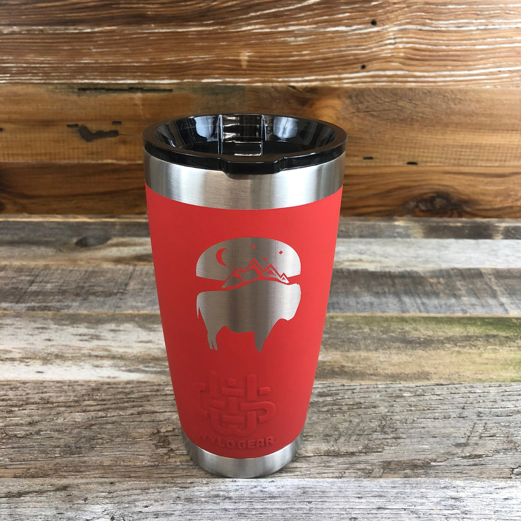 Bison Moon Tumbler | 20 oz | Red The WyoMade Bison Moon Tumbler is pure beverage containment for 20 ounces of your favorite hot or cold drink.  It comes with a smooth-flow sippy-lid for direct beverage enjoyment.  This Red colored Tumbler is designed for any Wyoming lifestyle and will surely allow you to roam free with your favorite beverage.  Bring some life to the herd with a Bison Moon Tumbler from WyoMade.
