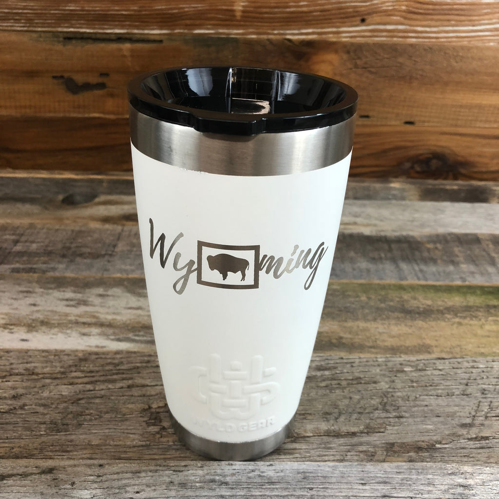 Wyoming Tumbler | 20 oz | White The WyoMade Wyoming Tumbler is pure beverage containment for 20 ounces of your favorite hot or cold drink.  It comes with a smooth-flow sippy-lid for direct beverage enjoyment.  This White colored Tumbler is designed for any Wyoming lifestyle and will surely allow you to roam free with your favorite beverage.  Bring some life to the herd with a Wyoming Tumbler from WyoMade.