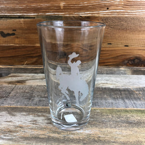 Steamboat Pint Glass | 16 oz Enjoy your favorite beverage in our 16oz capacity pint glass with the Wyoming Steamboat Logo.  Be a part of the herd with a Steamboat Pint Glass from WyoMade.  Capacity 16 oz    WyoMade is a Wyoming Craft Apparel brand located in the heart of Downtown Casper, Wyoming.