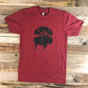 The New Bison Moon is a modern twist on our long time iconic T-shirt design from WyoMade Apparel! The Bison represents freedom and as a staple of Wyoming's open spaces. This Cardinal Red T-shirt is sure to appease your desire to roam free.  Be a part of the herd in a comfy dual blend Bison Moon T-Shirt deigned for both men and women.   WyoMade offers sizes ranging from XS- 2XL!
