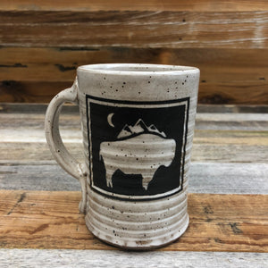 WyoMade | Bison Moon Coffee Mug | Ceramic The New Bison Moon is a modern twist on our long time iconic design from WyoMade!   The Bison represents freedom and is a staple of Wyoming's open spaces. This Wyoming Made ceramic coffee mug is sure to appease your desire to roam free.  Be a part of the herd with a Bison Moon Coffee Mug.