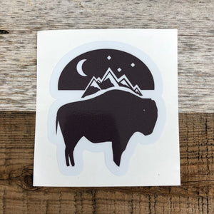 The New Bison Moon is a modern twist on our long time iconic design from WyoMade!   The Bison represents freedom and is a staple of Wyoming's open spaces. This sticker is sure to appease your desire to roam free.  Be a part of the herd with the Bison Moon design from Wyomade.        Size:  3.5 ""
