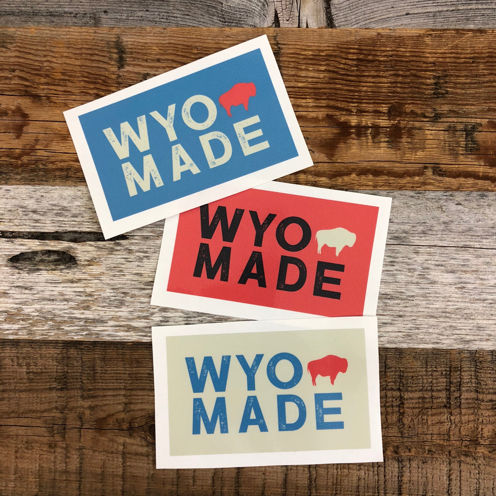 "The New Bison Moon is a modern twist on our long time iconic design from WyoMade!   The Bison represents freedom and is a staple of Wyoming's open spaces. This sticker is sure to appease your desire to roam free.  Be a part of the herd with the WyoMade Tag Logo Sticker from Wyomade.     Size:  2.4"" x 4"""