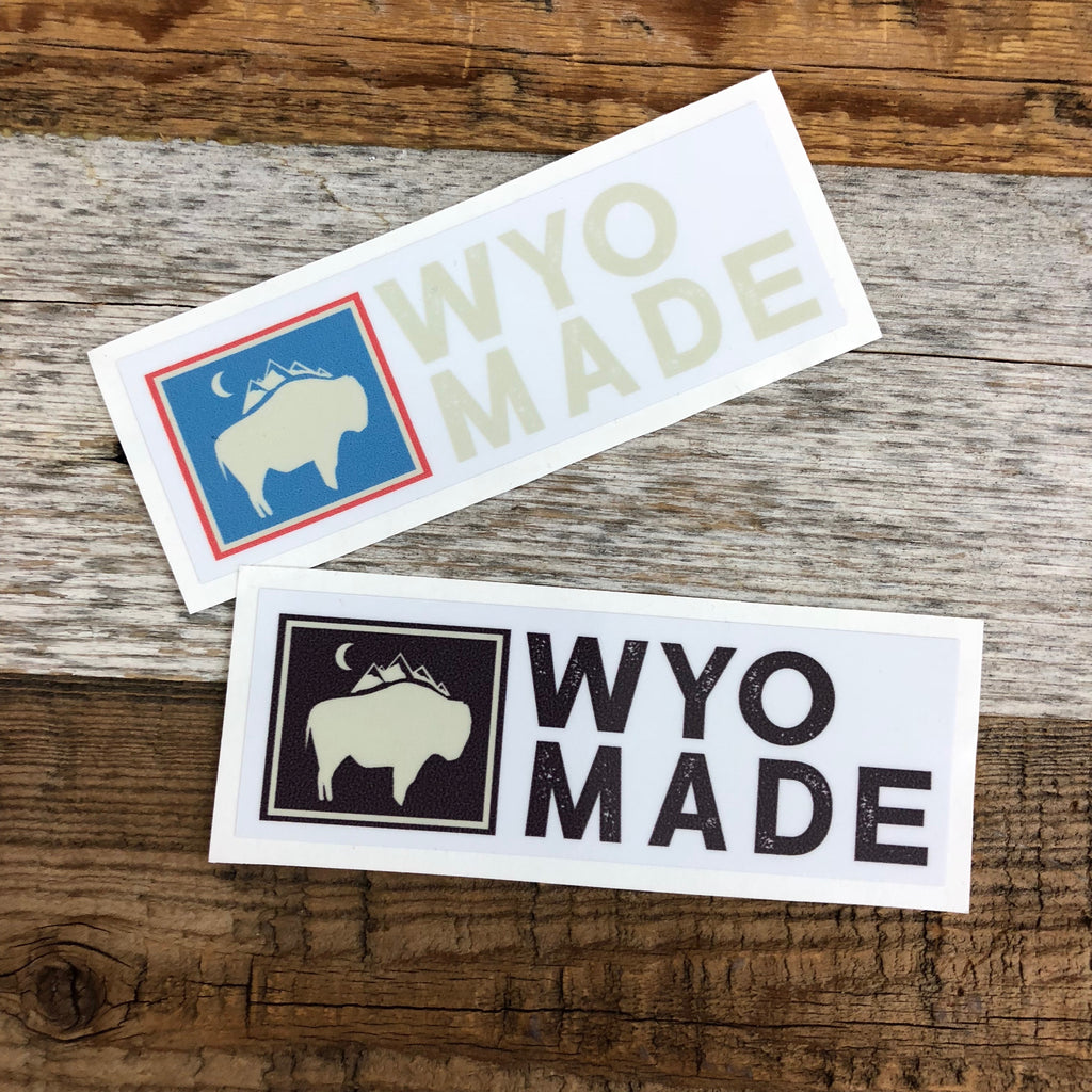 "The New Bison Moon is a modern twist on our long time iconic design from WyoMade!   The Bison represents freedom and is a staple of Wyoming's open spaces. This sticker is sure to appease your desire to roam free.  Be a part of the herd with the WyoMade Logo Sticker from Wyomade.     Size:  1.4"" x 4"""