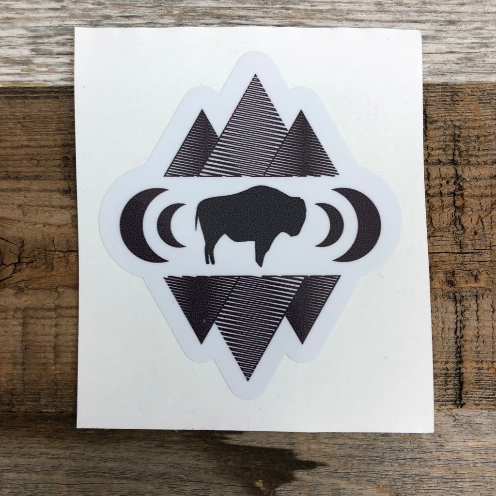 "The New Bison Moon is a modern twist on our long time iconic design from WyoMade!   The Bison represents freedom and is a staple of Wyoming's open spaces. This sticker is sure to appease your desire to roam free.  Be a part of the herd with the Geo Bison Sticker from Wyomade.     Size:  3"" x 3.5"""