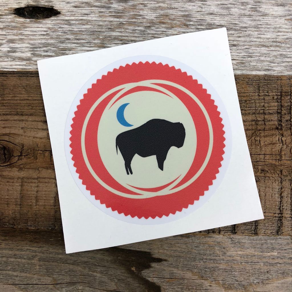 The New Bison Moon is a modern twist on our long time iconic design from WyoMade!   The Bison represents freedom and is a staple of Wyoming's open spaces. This sticker is sure to appease your desire to roam free.  Be a part of the herd with the Backwoods Bison from Wyomade.        Size:  3.5