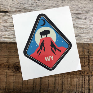 "The New Bison Moon is a modern twist on our long time iconic design from WyoMade!   The Bison represents freedom and is a staple of Wyoming's open spaces. This sticker is sure to appease your desire to roam free.  Set atop the Devils Tower National Monument, you'll be a part of the herd with the Tower Bison Moon Sticker from Wyomade.     Size:  3.3"" x 3"""