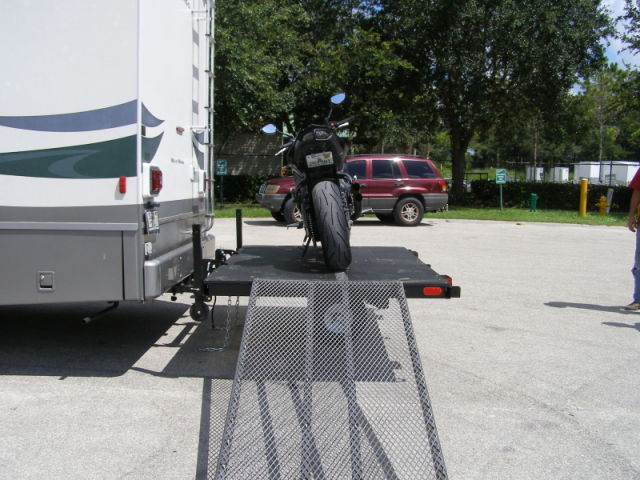 Swivelwheel Transport System,Swivelwheel Carrier, Swivelwheel Hauler, Motorcycle Carrier, scooter carrier, motorcycle hauler, scooter hauler, golf cart hauler, golf cart carrier, mini golf cart hauler, mini golf cart carrier, quickie mini golf cart hauler, quickie mini golf cart carrier, criket mini golf cart carrier, cricket mini golf cart hauler, dirt bike hauler, dirt bike carrier, carrier, hauler, atv hauler, atv carrier, singlewheel, sivelwheel 58, motorcycle, motorhome, fifth wheels