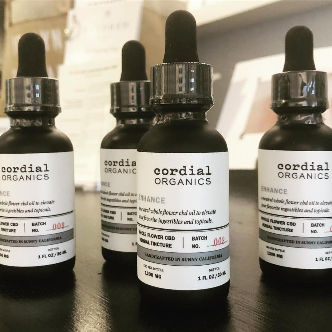 4 bottles of Cordial Organics Enhance 1200mg CBD Oil available at Curious Rick's Hemporium