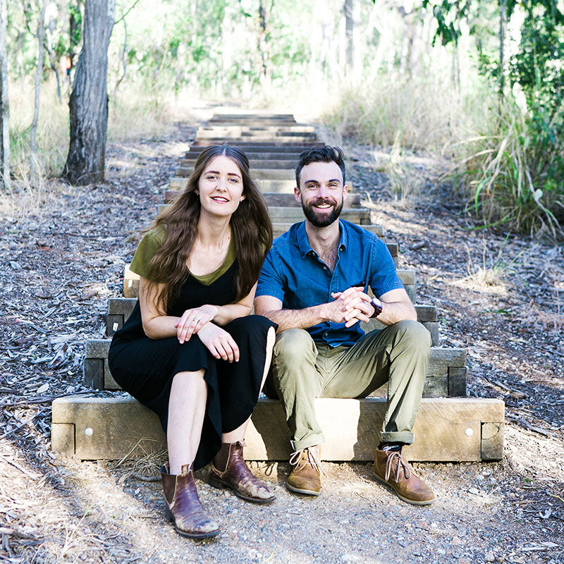 Corner Block Studio Founders Natalie and Leith sitting on the steps at Toheys Forest to tell out story.