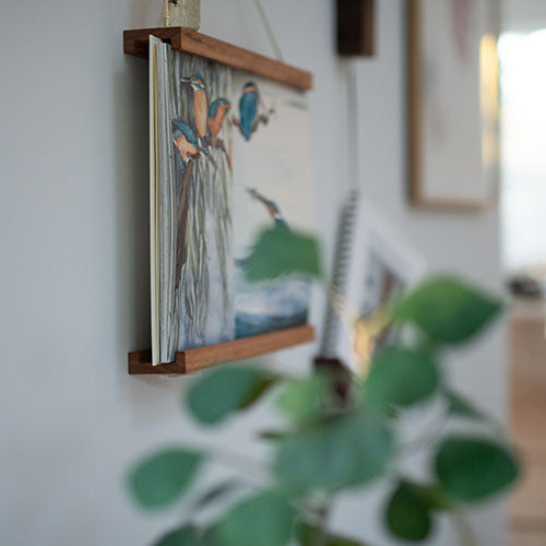 Book Frame with kingfisher and leaves in foreground