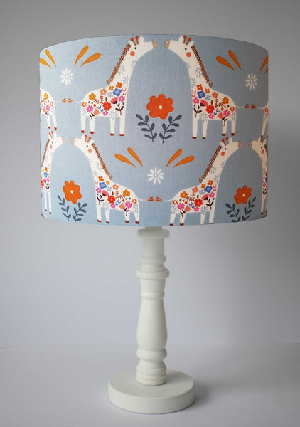 adorable giraffe table lamp shade on blue