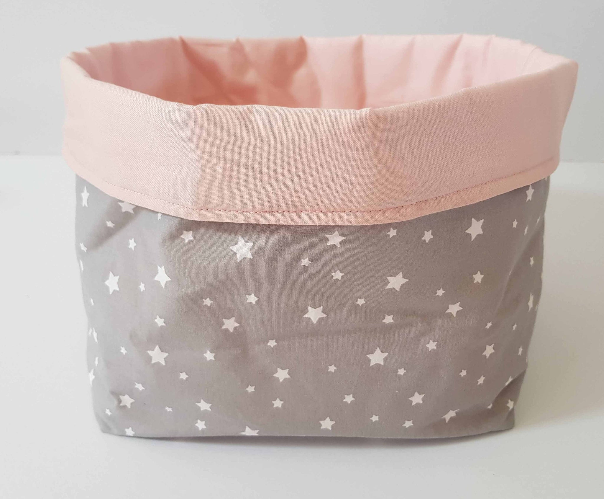 pink and grey star fabric storage bin