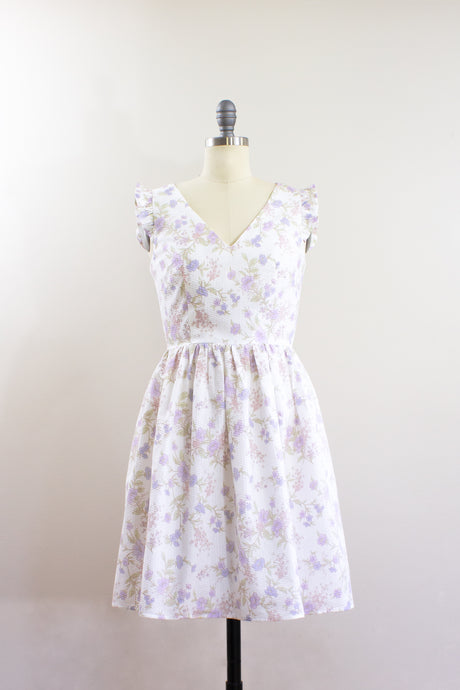 Elisabetta Bellu SS2020 Iris handmade floral seersucker short cotton dress with gathered skirt and ruffled armholes V neck front