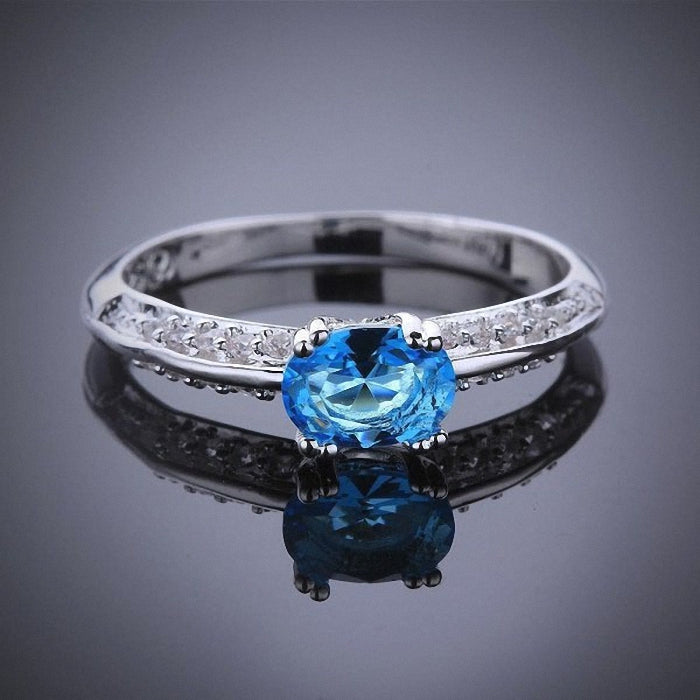 Stunning Topaz Sky Blue CZ Oval with White CZ accents in Sterling Silver plated Ring