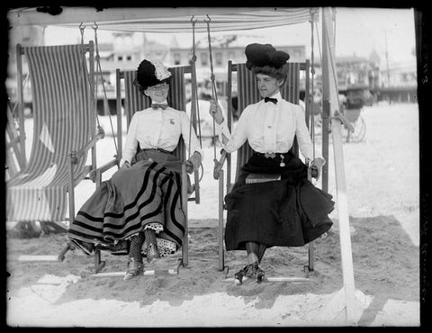women at beach fully clothed