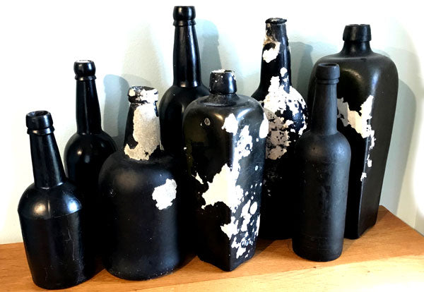 black glass sea glass bottles