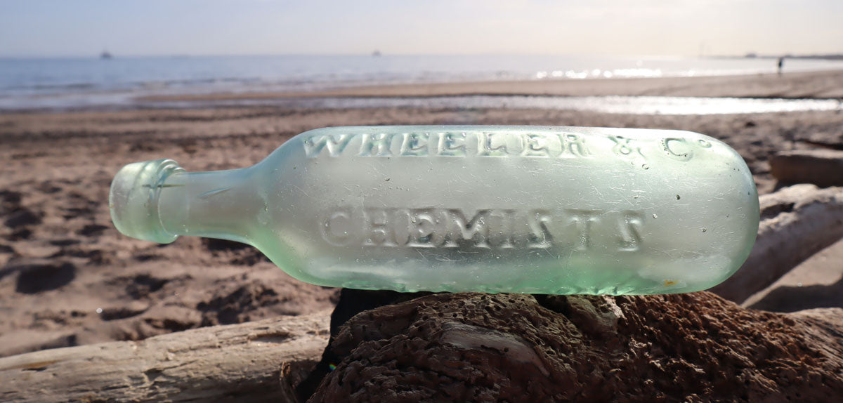 antique sea glass carbonated water bottle