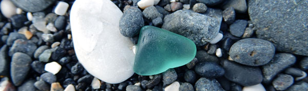 teal aquamarine sea glass on beach