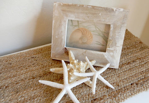 shells and starfish on dresser