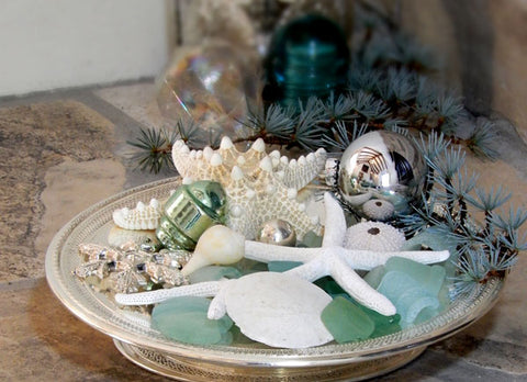 silver tray with shells and sea glass
