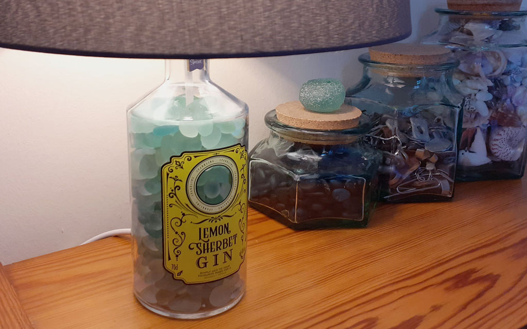 bottle lamp with sea glass or shells