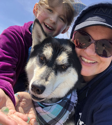 collecting beach glass with husky