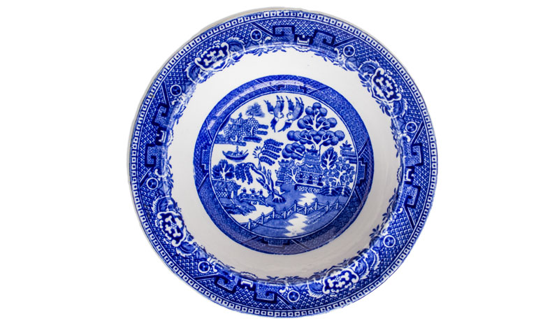 pottery plate with blue willow design