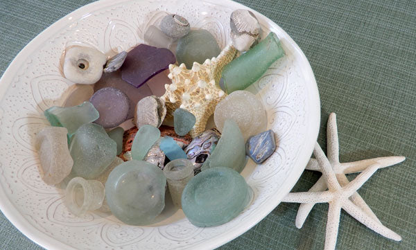 sea glass and shells in a bowl