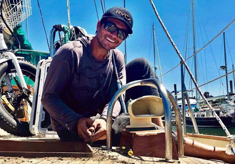 kyle davis on his sailboat searching for beach glass