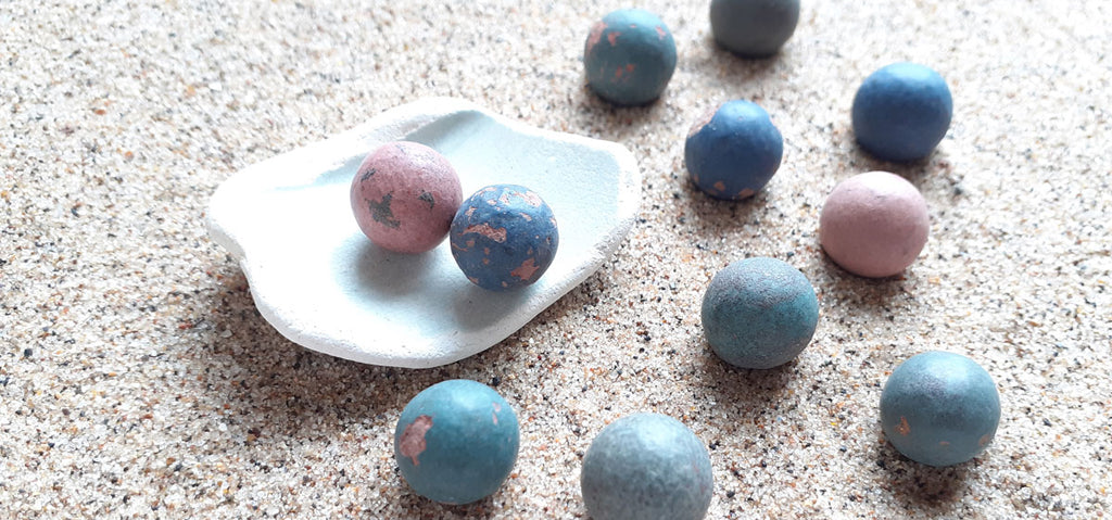 clay marbles found on beach in england