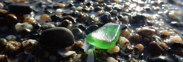 green beach glass on beach