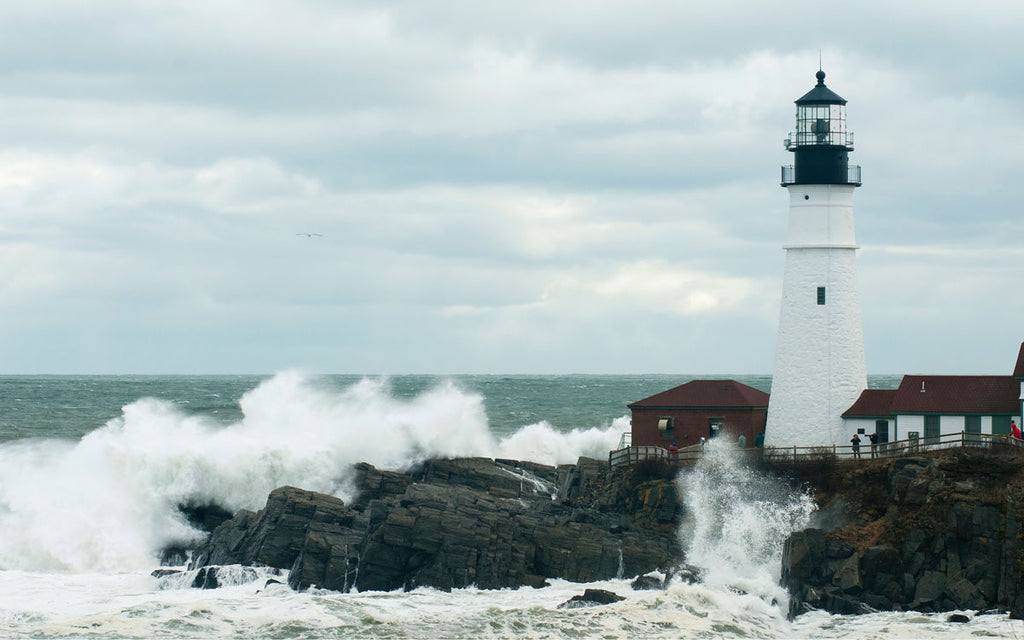 Astronomically high tides cause huge waves at the Portland Head Light in Cape Elizabeth, Maine.