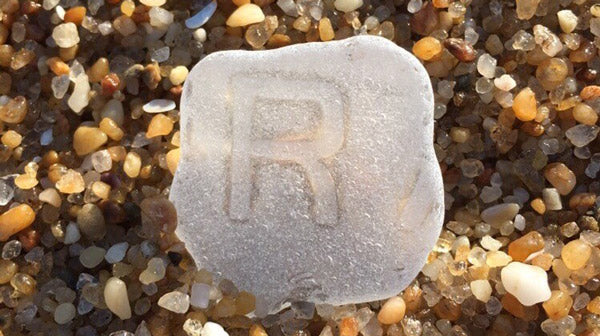 sea glass piece with R