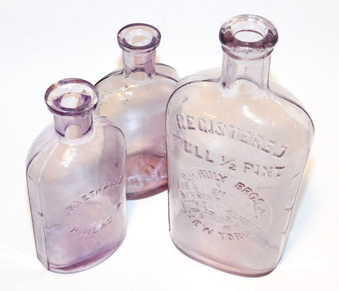 sun purple antique bottles