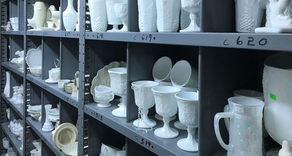 There's no shortage of milk glass, as illustrated by these shelves of vintage milk glass for sale in a thrift shop (Edgar Lee Espe).