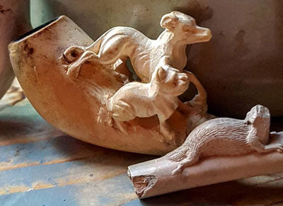 clay pipes with animals