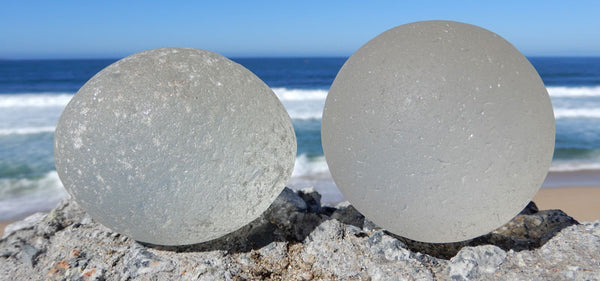 real and fake sea glass boulders with c marks