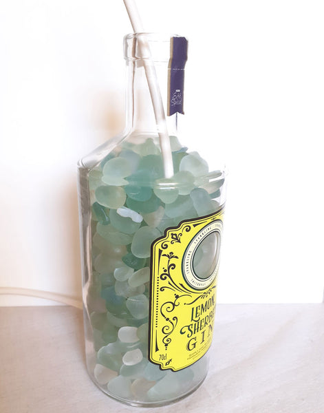 fill bottle with sea glass or shells