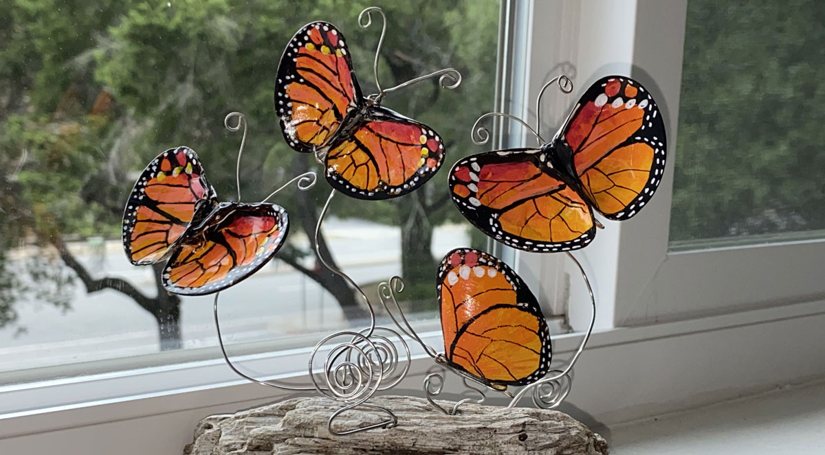 painted seashell butterflies on driftwood stand