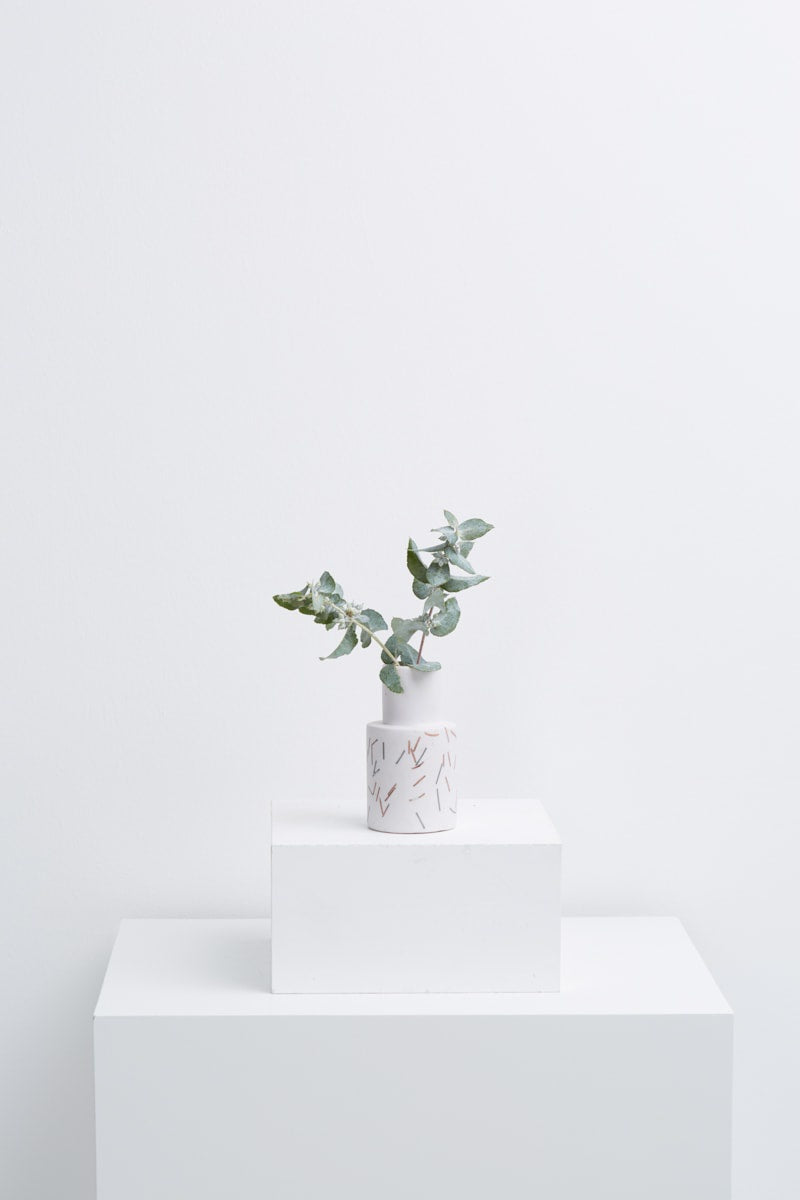 small vase in white match stick