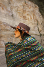 Load image into Gallery viewer, model wearing a green handmade wool rebozo and a brown hat boho vibes